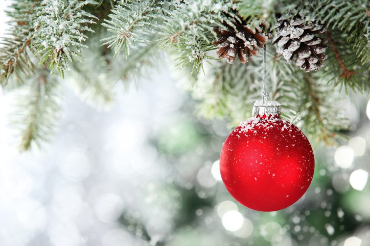 Up close photo of a red spherical Christmas ornament