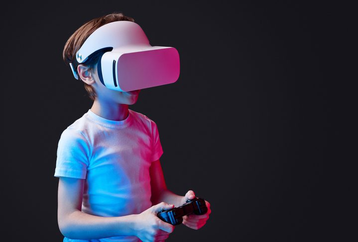 Boy gaming in VR goggles