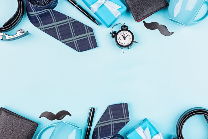 Happy Fathers Day background with wallet, gift box, coffee cup, pen, leather belt, funny moustache on table top view. Flat lay style, overhead, mockup, template, copy space.