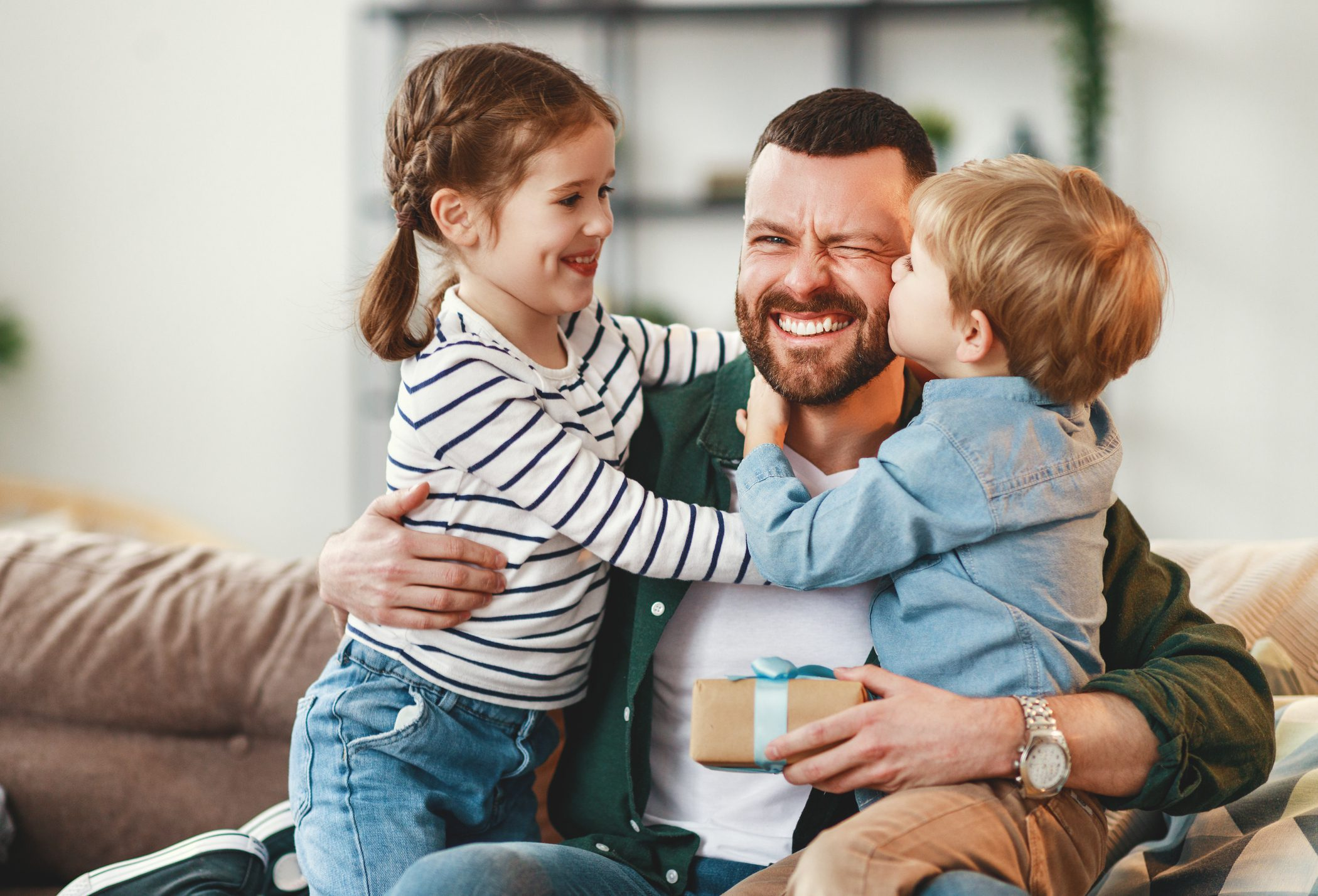 Happy father getting congratulations from kids